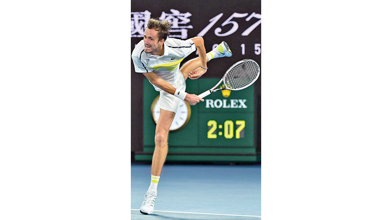 Russia's Daniil Medvedev hits a return.