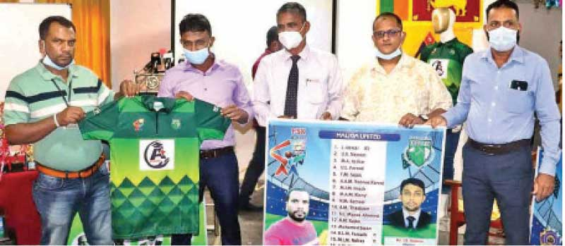 The new jerseys being handed over to members of the Miandad Sports Club, Sainthamaruthu