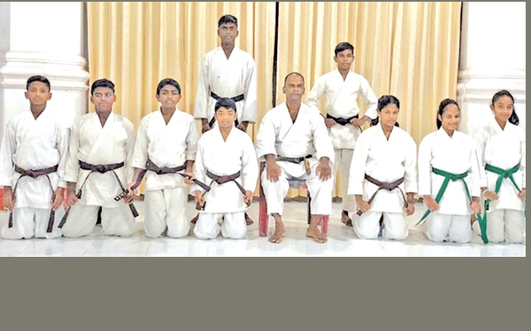 ISKU Karate Academy held their Grading Exam for Brown Belt and those who succeeded posed for a photograph with their coach. Nadun Chethana is in the front row first from left. (Picture by Dilwin Mendis Moratuwa Sports Special Correspondent)