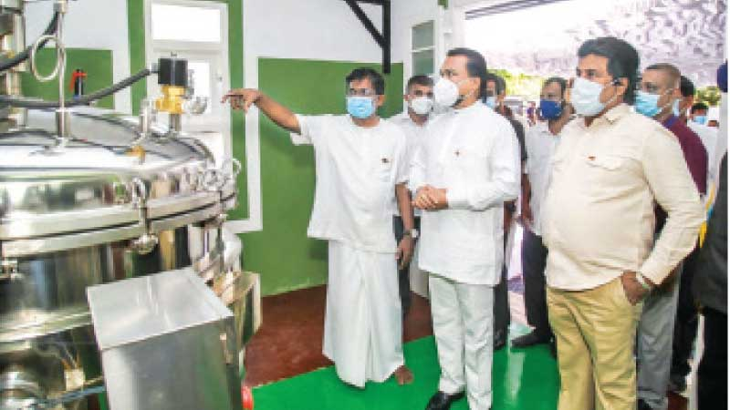 Minister of Industries, Wimal Weerawansa at the Ma product factory with Ministerty  and Ma foods officials