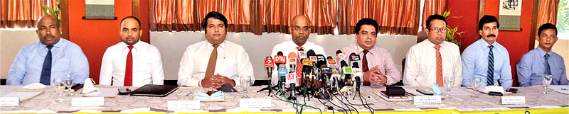 Ceylinco Insurance, Coconut Growers Association and Coconut Cultivation Board officials announcing the new insurance scheme for coconut plantations. Picture by Wimal Karunatillike