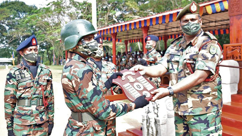 Major General Channa Weerasuriya, Commander Security Forces East providing the insignia.