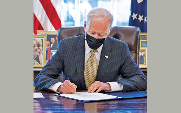 President Joe Biden signing the PPP Extension Act of 2021, in the Oval Office of the White House in Washington on March 31, 2020.