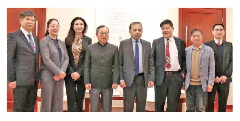 Ambassador Dr.Palitha Kohona with the officials.