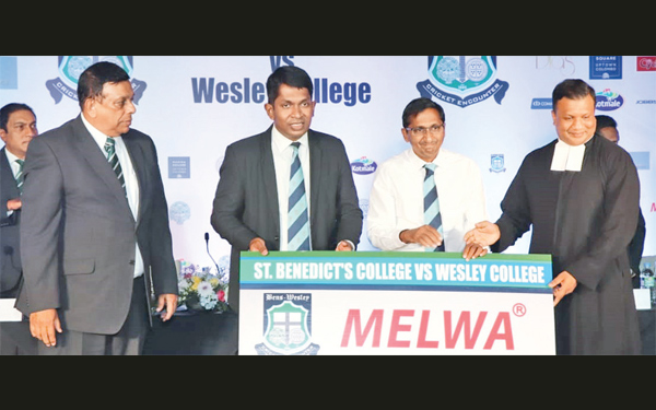 Avanka Fernando, Principal Wesley (second from left), receiving the Platinum sponsorship from Anandaraj, Director Melwa Holdings. Also in the picture are (from left): Lalith Madappulli, Joint President of St. Benedict's, Rev. Bro. Dr. Pubudu Rajapaksha, Director St. Benedict's.