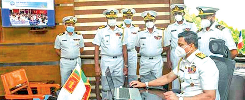 Navy Commander Vice-Admiral Nishantha Ulugetenne launching the 'Galle Dialogue 2021' official website, while others look on. Picture courtesy: Navy Media Unit.