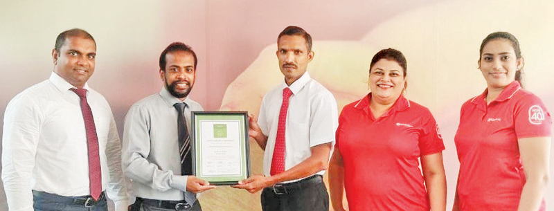 One of the participants from NDB Bank receiving the Six Sigma Green Belt certification.