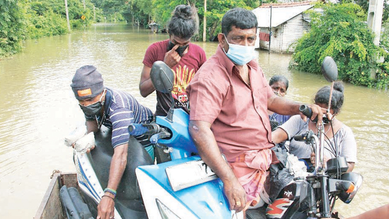 The Nattandiya Divisional Secretariat made arrangements to relocate those affected in flood prone areas due to the overflowing of Hamilton canal. Residents said the flood is caused by clogging of garbage and poor maintenance of the Hamilton Canal. Picture by Mihira Wijesekera, Marawila group corr.