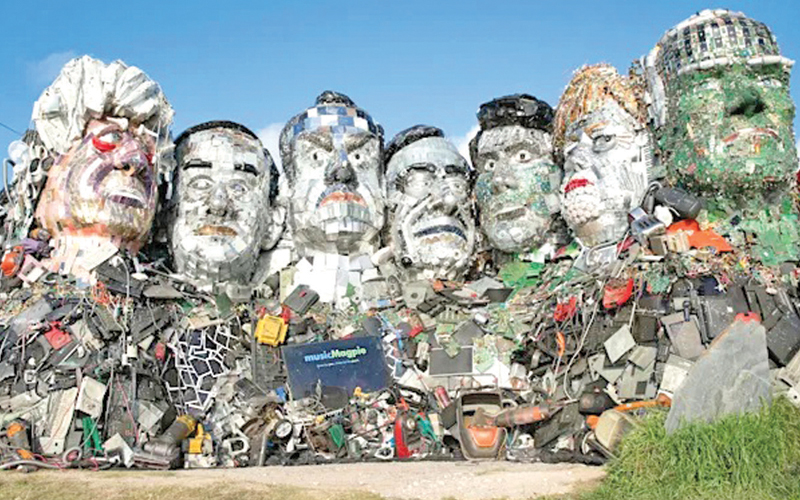 """A giant Mount Rushmore-style sculpture made out of electronic waste depicting G7 leaders has been erected in Cornwall. The imposing artwork, placed on the beach opposite the Carbis Bay Hotel where the summit is taking place, has been dubbed """"Mount Recyclemore"""" and aims to highlight the problem with electronics waste."""