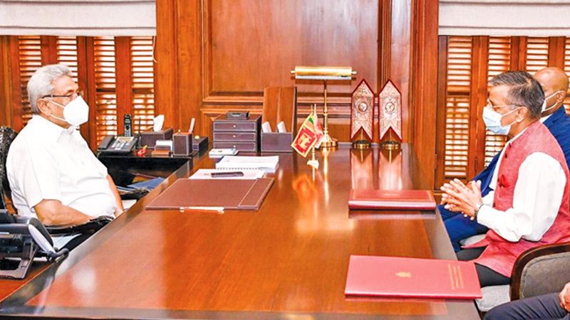 Indian High Commissioner Gopal Baglay having discussions with President Gotabaya Rajapaksa at the Presidential Secretariat yesterday morning after signing the agreement for the project. Picture courteay President's Media Division