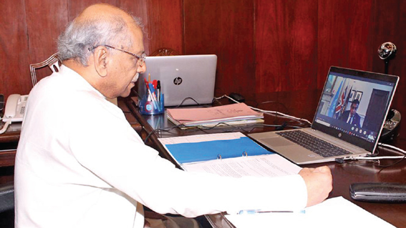 Foreign Minister Dinesh Gunawardena and UK Minister for South Asia and the Commonwealth Lord Tariq Ahmad exchanging views.