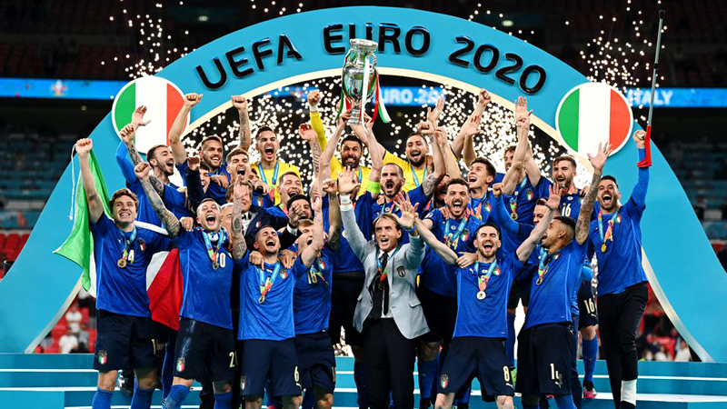 Italy celebrate their win with the trophy