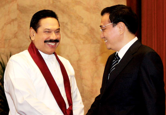 President Mahinda Rajapaksa and the Sri Lankan delegation were welcomed by Chinese Prime Minister Li Keqiang at the Great Hall of the People yesterday in Beijing. At the discussions, Chinese Prime Minister Li Keqiang assured President Mahinda Rajapaksa that the trade imbalance, which is now in favour of China, will soon be addressed to benefit Sri Lanka as well. He also said China will be exploring the possibility of establishing an industrial zone in Hambantota. Picture by Sudath Silva