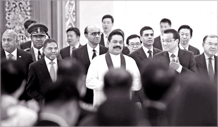 President Mahinda Rajapaksa arriving at the Global Services Forum Beijing Summit yesterday at the China National Convention Centre. President Rajapaksa addressed the opening ceremony of the Global Services Forum Beijing Summit. In his speech, the President spoke of the significance of creating greater synergies between nations as Asian countries transform to become service-driven economies.Picture by Sudath Silva