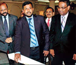 Minister Bathiudeen launching Expo 2014 mega fair at the 'Soft launch of Expo 2014 at Kingsbury Hotel, Colombo as Commerce and Industry Ministry  ecretary Anura Siriwardena and Chairman EDB Bandula Egodage look on. Picture by Geeth De Mel