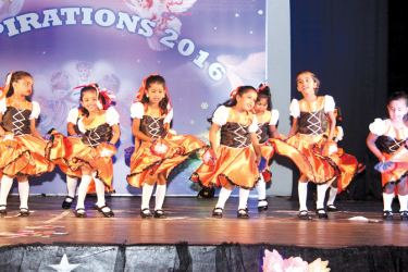 A group of children dancing at the concert