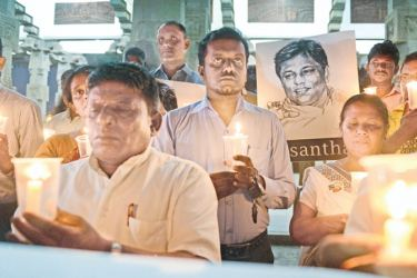 """The Free Media Movement  organised a vigil event to commemorate the journalists  who sacrificed their lives in order to safeguard the freedom of expression and to demand justice for theme on  """"Two Years of Good Governance – January is Still Black yesterday  at the  Independence Square,  Picture by Saman Mendis"""