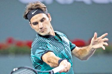 Roger Federer of Switzerland plays a forehand during his straight sets victory against Stephane Robert of France in their second round match during day seven of the BNP Paribas Open at Indian Wells Tennis Garden on March 12, 2017 in Indian Wells, California.