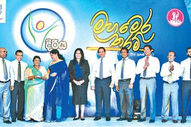 R. N. Ranjani  the Saubhagya entrepreneur who received the prize at the Diriya Pranama Awards on stage with the event's chief guest, Malini Fonseka and representatives of the Samurdhi Authority, Unilever Sri Lanka and its partners.