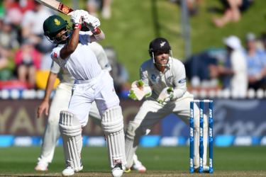 South Africa's Temba Bavuma pulls a ball watched by New Zealand's keeper BJ Watling (R) during day two of the second Test cricket match between New Zealand and South Africa at the Basin Reserve in Wellington on March 17, 2017.  AFP