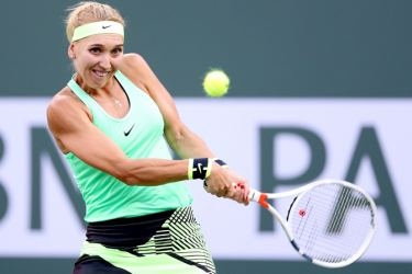 Elena Vesnina of Russia returns a shot to Venus Williams during the BNP Paribas Open at the Indian Wells Tennis Garden on March 16,