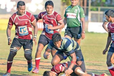A Science College player is brought down by a Wesleyite but has more support coming his way from two team–mates in the schools 'A' Division League rugby match played at Longden Place yesterday which Wesley won 36-10.  Picture by Samantha Weerasiri