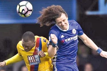 Chelsea's David Luiz in action with Crystal Palace's Christian Benteke in their Premier League match at Stamdord Bridge on Saturday.