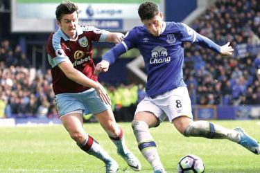 Everton's Ross Barkley scores their second goal in their Premier League match against Burnely at Goodison Park on Saturday.
