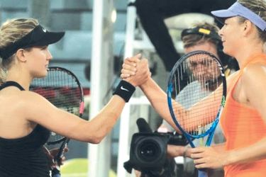 Eugenie Bouchard and Maria Sharapova exchanged a brief handshake after the match. Picture courtesy -BBC