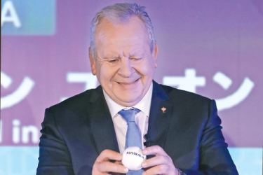 Chairman of World Rugby Bill Beaumont draws Australia into Pool D during the Rugby World Cup 2019 pool draw at the Kyoto state guesthouse in Kyoto on May 10. AFP