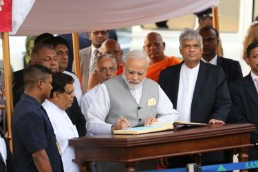 Indian Prime Minister Narendra Modi arrived in the country yesterday on a two-day visit at the invitation of President Maithripala Sirisena to participate in the UN International Day of Vesak celebrations as the Chief Guest. The Indian Prime Minister was warmly received by his Sri Lankan counterpart Prime Minister Ranil Wickremesinghe on arrival at the Bandaranaike International Airport in Katunayake. Here, Prime Minister Modi is seen signing the Special Visitors book at the BIA. Picture by Rukmal Gamage