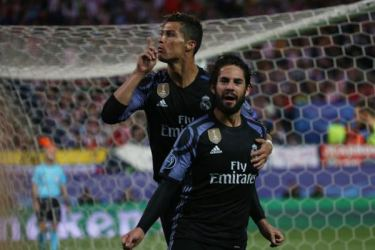Real Madrid's Isco celebrates scoring their first goal with Cristiano Ronaldo in the UEFA Champions League semi-final second leg against Atletico Madrid at Vicente Calderon Stadium, Madrid on Wednesday.