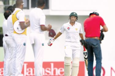West Indies players form a guard of honour for Pakistan cricketer Younis Khan who is playing his final Test match on the opening day of the third and final Test at Roseau, Dominica on Wednesday. AFP