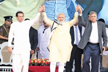 Indian Prime Minister Narendra Modi addressed a public rally at Norwood after opening the Dickoya Base Hospital funded by the Government of India. Picture shows the Indian Premier with President Maithripala Sirisena and Prime Minister Ranil Wickremesinghe greeting the public. Picture by  Rukmal Gamage