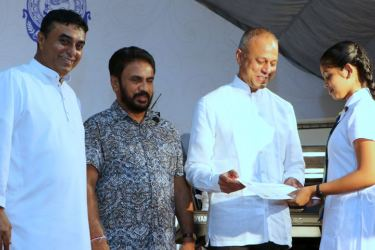 The third day of the Lake House Amadahara Vesak Zone was inaugurated by Minister of Law and Order and Southern Development Sagala Ratnayaka yesterday. Here, Minister Ratnayaka presents a certificate to a winner of the essay competition. IGP Pujith Jayasundera and Parliamentary Reforms and Media Ministry Secretary Nimal Bopage are also in the picture. ANCL Chairman Kavan Ratnayaka, the Board of Directors, Senior members of the management and staff members were also present. Picture by Saman Sri Wedage