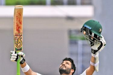 Opener Azhar Ali of Pakistan celebrates after scoring 100 against the West Indies, during the second days of play of the 3rd and final test match at the Windsor Park Stadium in Roseau, Dominica on May 11, 2017. The series is level with one match all.  AFP