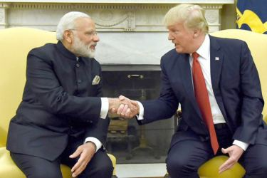 US President Donald Trump shakes hands with Indian Prime Minister Narendra Modi in the Oval Office of the White House in Washington on Monday.