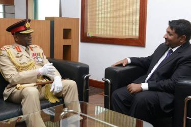 Defence State Minister Ruwan Wijewardene and New Commander of the Army Lieutenant General Mahesh Senanayake engaged in discussion at the Ministry yesterday.