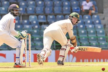 Craig Ervine who held the Zimbabwe innings together with his second Test century sweeps for runs on the first day of the one-off Test against Sri Lanka at the R Premadasa Stadium yesterday. (Pix by Saman Mendis)