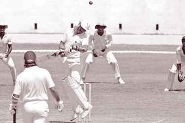 Graham Gooch avoids a bouncer during his superb first-innings 51.