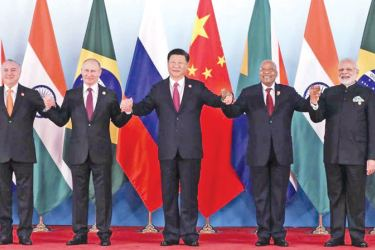 From left, Brazil's President Michel Temer, Russian President Vladimir Putin, Chinese President Xi Jinping, South Africa's President Jacob Zuma and Indian Prime Minister Narendra Modi pose for a group photo during the BRICS Summit at the Xiamen International Conference and Exhibition Center in Xiamen, southeastern China's Fujian Province on Monday.