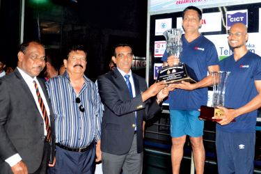The skipper of the champion MAS Holdings swimming team receiving the President's Trophy from Chief Guest I.P. Wijeratne, Director Sports of the Sports Ministry.