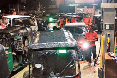 Our staff photographer Ruwan De Silva captured long queues for petrol in Colombo sheds last night.