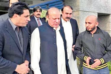This photo released by the Pakistan Muslim League shows ousted Pakistani Prime Minister Nawaz Sharif as he arrives to Punjab house, a PML party residence, in Islamabad on Thursday.