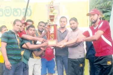 The mens champions of the cricket tournament Avenjars 'B' boys team is seen here with their trophy.   Pix by Malawana Group Correspondent – Mahanama Vithanage