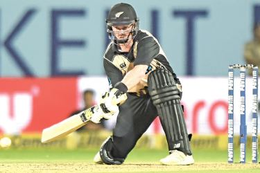 New Zealand batsman Colin Munro plays a shot during his century in the second T20 international against India at Rajkot on Saturday. AFP
