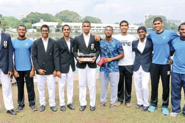 Champion Thomian rowers posing with their trophy.