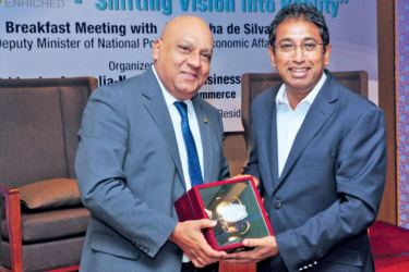 Deputy Minister of Policy Planning and Economic Development, Dr. Harsha De Silva receiving a token from President SLANZBC, Gerard Victoria. Picture by Wasitha Patabandige