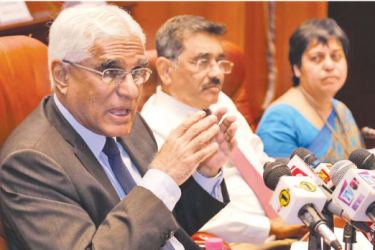 Governor Dr Indrajit Coomaraswamy speaks at the news conference to announce the Bank's seventh monetary policy review. Senior Deputy Governor Dr P. Nandalal Weerasinghe and Director, Economic Research, Dr. Y.M. Indraratne look on. Picture by Chinthaka Kumarasinghe