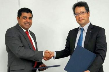 Dr. Nayana Dehigama, Executive Chairman, Epic Technology Group, exchanging the MOU with TechnoBrave President Sadao Kawada in Japan recently.